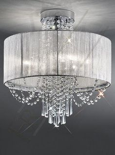 The Empress Ceiling Light by Franklite Lighting is available from Luxury Lighting. The Franklite Empress Ceiling Light is in a chrome finish with a drape of crystal glass drops cascading through a silver shade.