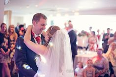 First dance watched by wedding guests at Harbour Heights wedding photos. Photography by one thousand words wedding photographers