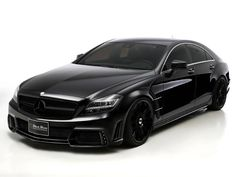 Got racks on racks like my whips black on black , Mercedes CLS AMG