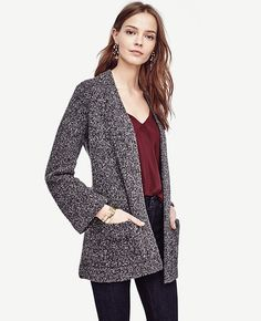 "Coat and cardigan rolled into one, our marled coatigan is done in a rich wool blend - and topped with patch pockets - to keep you at your coziest. Open front. Long sleeves. Patch pockets. 29 1/2"" long."