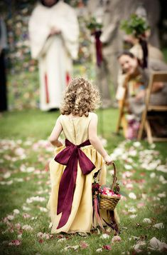 Super cute flower girl walks down the aisle, photo by Woodward and Rick Photographers
