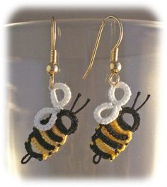 Itty Bitty Bumblebee earrings tatted by CarolIvy - I can't access the site to see if there is a free pattern, but these are too cute to not pin!  It's using block tatting