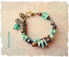 Inspired by the colors of the rocky Pacific coastline, this chunky gemstone, and sea glass, bracelet is perfect for anywhere you love to be. A large sea glass bead is paired with amazonite, African turquoise, freshwater pearls, ceramic and glass beads and shell. Antique brass is used
