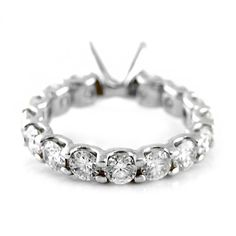 Brilliant Cut Diamond Eternity Band Semi-Mount. Round brilliant cut eternity style mounting, with 3.00ctw round brilliant diamonds, set in 14kt white gold.