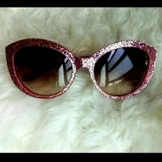 CLOSET CLEAROUT!  Kate Spade Rose Glitter Sunnies Sophisticated, stylish, FABULOUS!  Just a few of the words to describe the woman who wears these sunnies.  Could it be you?  Pink sparkly frames.  Spade insignia on the arms  NOTE: Matching wristlet is available in my closet listings. Bundle them and SAVE! kate spade Accessories Sunglasses