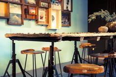 Beautiful artwork, bar stools and rustic / industrial tables from gusj.com