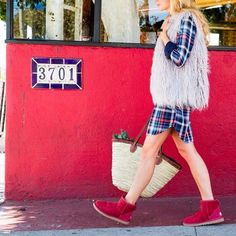Pin for Later: You Won't Believe How Ridiculously Stylish You Can Look in a Pair of Uggs To Bring Out the Red Stripes in Your Plaid Shirt Dress