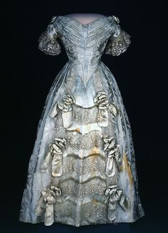 First Lady Sarah Polk first wore this light-blue brocaded silk dress woven with a design of poinsettias in the late 1840s. It was remade as an evening gown, probably for her niece, in the 1880s.