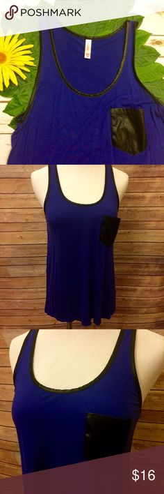 """Royal Blue Tank With Faux Leather Pocket Dress this beauty up or down! Gorgeous royal blue color tank with faux leather lining around arm holes and neck. Features a faux leather pocket on front. High low hem. Very good condition. Shoulder to hem: 25"""" front, 27"""" back. Xhilaration Tops Tank Tops"""