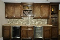 View of wet bar from den with fantastic marble counters/built in wine rack,wine chiller/fridge and built in display