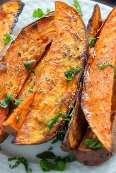Extra Crispy Sweet Potato Wedges - oven baked and made with simple ingredients. These are SO addicting! Perfect for a Thanksgiving or Christmas side dish, or to go with a burger on a random weeknight. LOVE sweet potato fries!