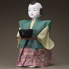 """The Gakken Tea Serving Robot is designed to be a replication of the karakuri zui, an illustrated manual written in the Edo period (1603-1868). This mechanical doll has a tray that holds a cup of tea, and it is designed to approach the guest with the tea, bow his head, and then carry the empty teacup away. Using only springs as power, the term """"robot"""" might at first seem a little strange, as there is no electricity used"""