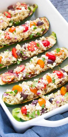 Greek Quinoa Grilled Zucchini Boats, with olives, tomatoes, and feta! These Mediterranean stuffed zucchini are easy, healthy, vegetarian, and gluten free!   www.kristineskitchenblog.com