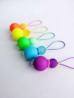 It's really fun and pretty easy to make your own knitting stitch markers, and this tutorial from My Poppet shows you how to make a rainbow of markers with multicolored wire and coordinating b…
