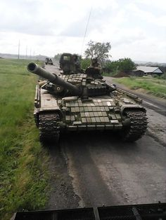 Novorossiyan T-72A with added reactive armor.