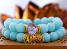 Frosted Matte Baby Blue Jade Stretch Bracelet with Gold Plated Wavy Disks
