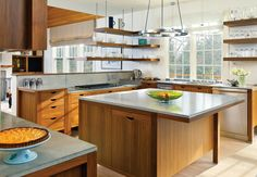 """The cabinetry in this kitchen is inspired by Danish design and has a true """"furniture"""" look"""