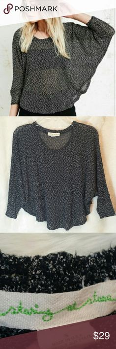 Anthropologie Staring At Stars Crop Swing Sweater Anthropologie Staring At Stars Crop Swing Sweater. Knit long sleeve sweater. Black and white. Preowned in great condition with no rips, holes, tears or stains. Size small. 49% polyester, 46% rayon and 5% spandex. Anthropologie Sweaters