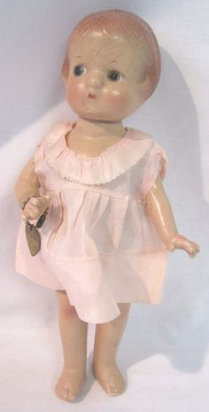 """Cute 9 1/2"""" doll wearing an original pink dress, which is tagged. This is Tiny Patsyette, by Effanbee from 1931. All composition, fully jointed, with molded red hair and painted eyes."""