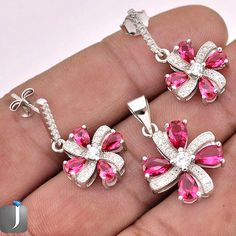Enticing silver jewelry set including silver pendant and a pair of silver earrings embellished with topaz and ruby gems..!! #jewelexi #jewelrysets