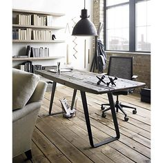 Urban Rustic - reclaimed wood for an office desk - metal hanging lights and wire frame basket - tools on the walls - add a bit of history to everything