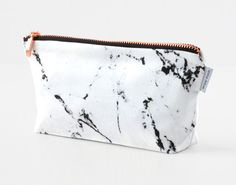 Marble & Copper Makeup Bag by Renna Deluxe, $22; at Etsy
