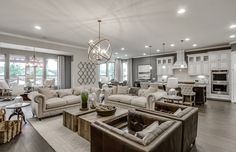 We'd love to come home to a living space designed with cool grays and reclaimed wood. | Pulte Home