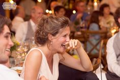 We love capturing candids of wedding guests and family members to tell the story of our couples' wedding day... great photo of the groom's sister laughing during one of the speeches from this rustic Stowe, VT wedding.