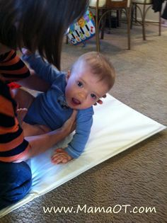one trick for helping a baby learn to roll