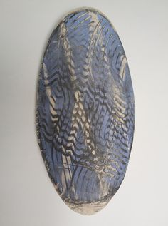 Black White & Blue - Shield by Niqui Kommerkamp. Ceramic wall object 43 x 21 x 6 cm.