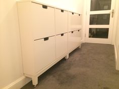 Work in progress hallway... IKEA STÄLL shoe storage units with brushed nickel furniture knobs added to the feet (to clear high baseboards)