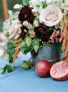 Pomegranate accented wedding centerpiece: http://www.stylemepretty.com/2015/12/21/elegant-southern-wedding-inspiration/ | Photography: Elisa Bricker - http://elisabricker.com/