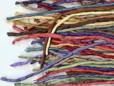 Hand-dyed silk cords, made in the USA.