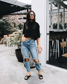 cropped black top with ripped knee jeans and black sandals