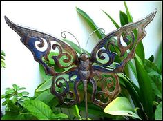 Recycled metal garden art -Enjoy this butterfly plant marker as part of yourgarden decor. Plant stake has been hand cut from recycled steel drums at our workshop in Haiti. Tropical Design – Metal Art – Tropical decorating – Tropical design - Caribbean decor - Metal tropical art - Tropical decorations - Tropical art - Tropical home décor - Tropical metal art - Caribbean decor - Plant stake, Plant stick - Haitian Metal Art, Recycled Steel Drum Art of Haiti, Handcrafted Metal Art - Haitian…