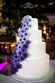 Purple ombre roses wedding cake | This is amazing! Head over to Bali Pixtura where you can see more of their unique works http://www.bridestory.com/bali-pixtura/projects/jeff-sonya-wedding
