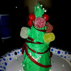 Best Christmas food craft EVER. Ice cream cone, green frosting, candy ornaments. Decorate--eat--enjoy!