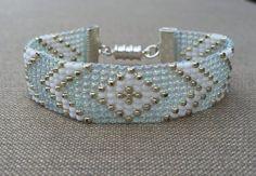 Aqua, Silver, and White Bead Loom Bracelet Rope Jewelry, Seed Bead Jewelry, Jewelry Crafts, Beaded Jewelry, Jewelery, Loom Bracelet Patterns, Bead Loom Bracelets, Bead Loom Patterns, Beading Patterns