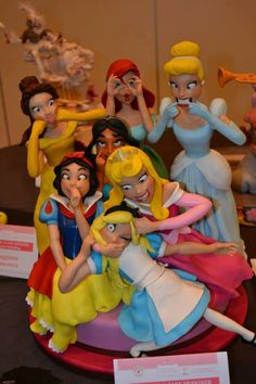This is so funny. Disney Princess doing Photo Bombing. And it is Cake