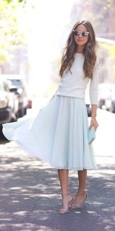 To create an outfit for lunch with friends at the weekend opt for a white crew-neck sweater and a light blue pleated midi skirt. Take a classic approach with the footwear and grab a pair of grey suede heeled sandals.