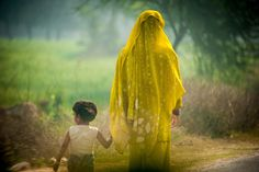 "National Geographic Traveler Magazine: 2012 Photo Contest. Category: Travel Portrait. ""Motherhood: Calm Silence shared between a mother and daughter amongst the frenzied traffic along the road to Agra."" Love the lighting."