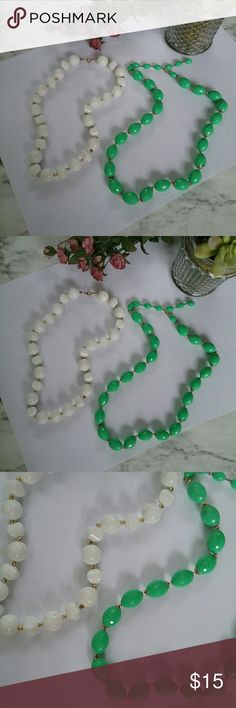 TWO PIECE VINTAGE NECKLACES GREEN WHITE This is a two-piece lot of vintage style plastic beaded necklaces. There is one faceted style green mint green one and one white one. Unbranded Jewelry Necklaces