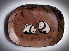 Brown stoneware panda family plate with brushpainted bamboo. Smokey brown exterior. Available at the Torpedo Factory Studio 19 in Alexandria, Va.