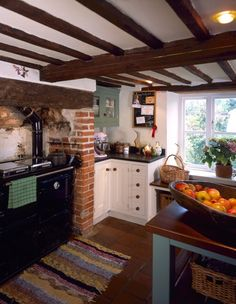 Country kitchen with Rayburn.  Who wouldn't love a Rayburn!