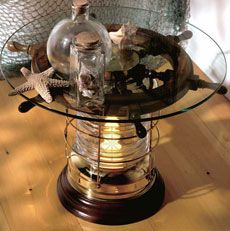 table made from a captain's wheel and a ship's lantern  ~