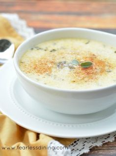 Cod and Smoked Oyster Chowder with paprika and fresh sage garnish on top of the chowder