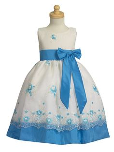 Girls in white dresses with blue satin sashes -- Easter?