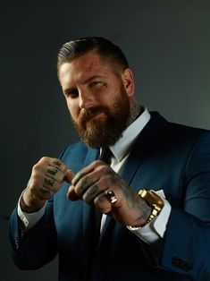 Beaded paradox. Tough guy in a suit. (beards, tattoos, men's suits, bearded men).