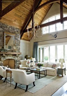 vaulted wood ceiling, french chandelier, stone fireplace