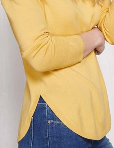 Erica: I like how this sweater goes up at waistline! Good color too   Curved Hem Sweater